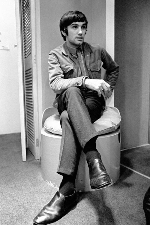George Best relaxing in his fashion boutique.