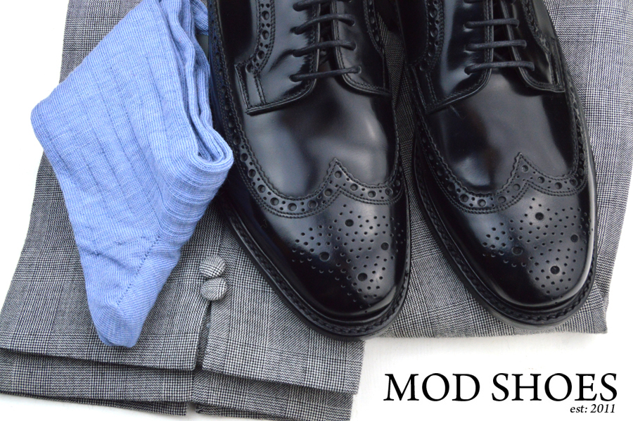 mod shoes loake black royals with prince of wales check trousers and light blue socks