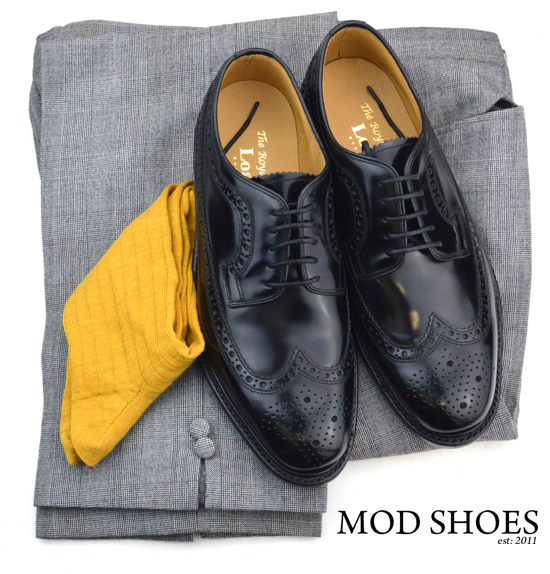 mod shoes loake black royals with prince of wales check trousers and mustard coloured socks