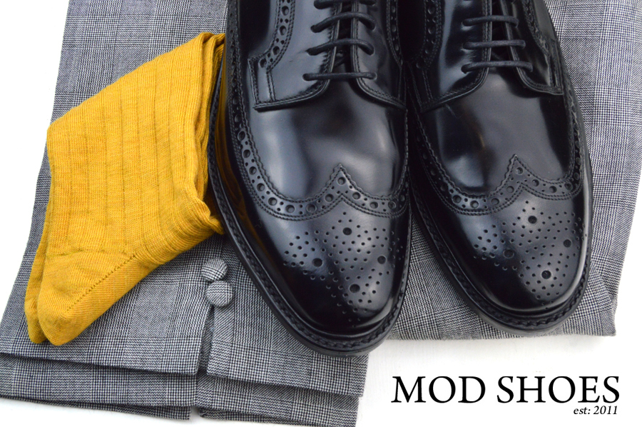 mod shoes loake black royals with prince of wales check trousers and mustard socks